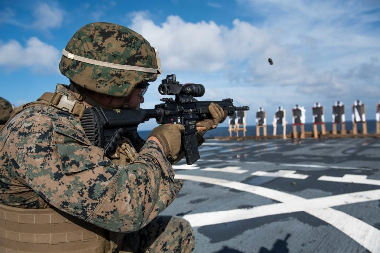 Marine of the 31st Marine Expeditionary Unit, fires an M27