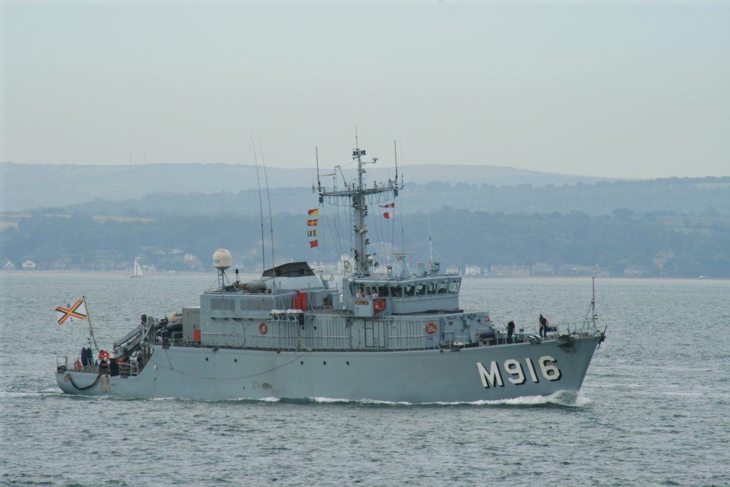 The Belgian minesweeper BNS Bellis at Spithead, inbound to Portsmouth Naval Base on 09 July 2010 in company with the Belgian minesweeper support ship BNS Godetia and the minesweeper BNS Primula.