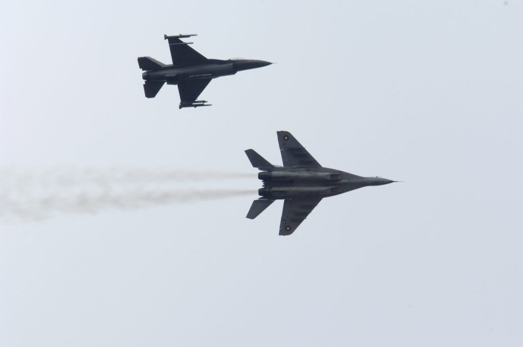 Bulgarian Air Force MiG-29 (bottom), joined by a U.S. Air Force F-16 (top) during exercise Nickel Javelin over Bulgaria, 10 November 2008