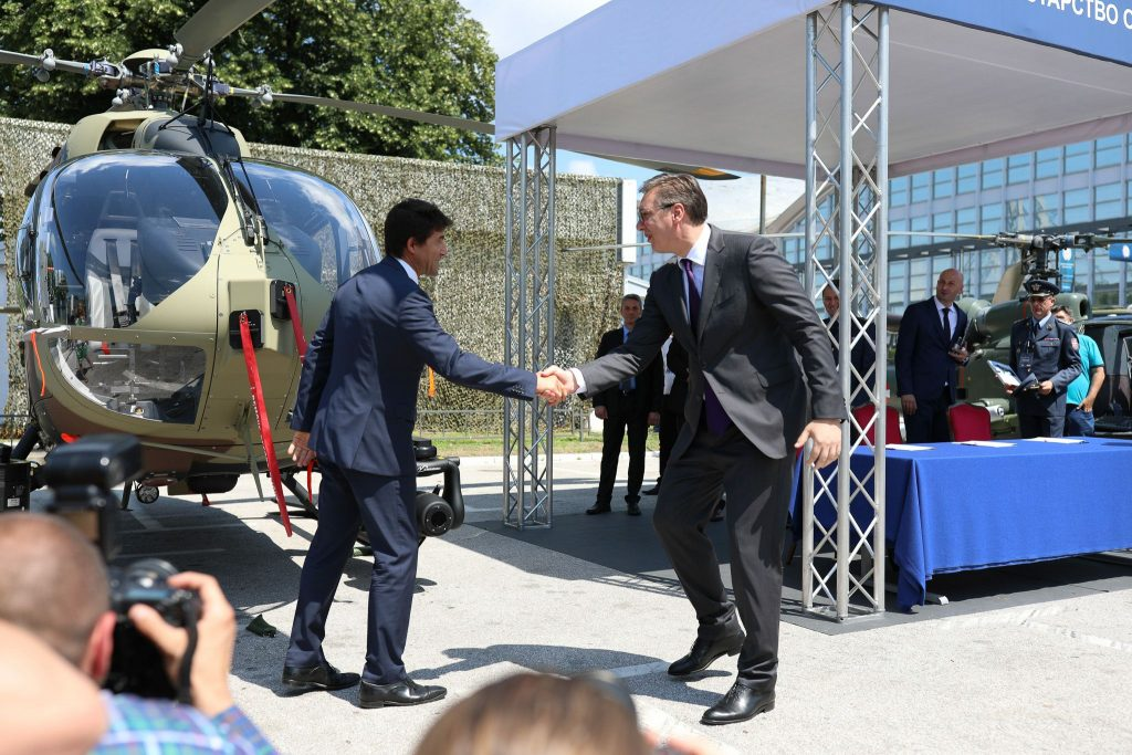 Serbian Minister of Defense Aleksandar Vulin and Airbus Helicopters Germany CEO Wolfgang Schoder shake hands in 2018 (photo courtesy of Airbus Helicopters)