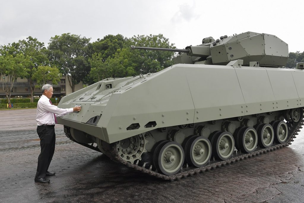 Defense Minister Ng commissions the Hunter Armored Fighting Vehicle by affixing the licence plate on the platform (courtesy Singapore Ministry of Defense)