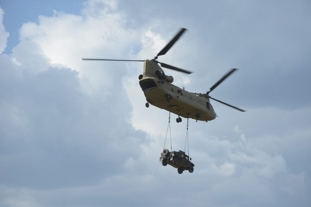 A U.S. CH-47F Chinook Helicopter assigned to Bravo Company, 1st Battalion, 214th Aviation Regiment, 12th Combat Aviation Brigade conducts sling load procedures at the 7th Army Training Command's Grafenwoehr Training Area, Germany, July 26, 2018. (U.S. Army photo by Christoph Koppers)