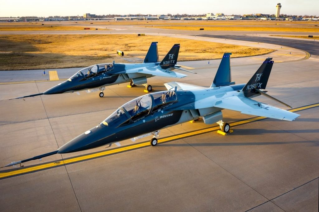 Two Boeing T-X aircraft parked on a taxiway (photo courtesy of U.S. Air Force Secretary of Public Affairs)