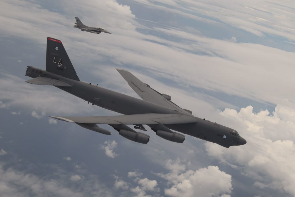 A U.S. Air Force B-52 Stratofortress assigned to the 2nd Bomb Wing, Barksdale Air Force Base, Louisiana, flies next to an Indonesian Air Force F-16 during a Bomber Task Force (BTF) deployment in the Indo-Pacific region, Sept. 1, 2021. This is the first time a B-52 has integrated with the Indonesian Air Force during flight. BTF missions demonstrate the credibility of our forces to address a diverse and uncertain security environment. (Courtesy Photo of Indonesian Air Force)